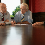 three persons in meeting