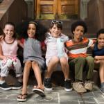 five children sitting at the door